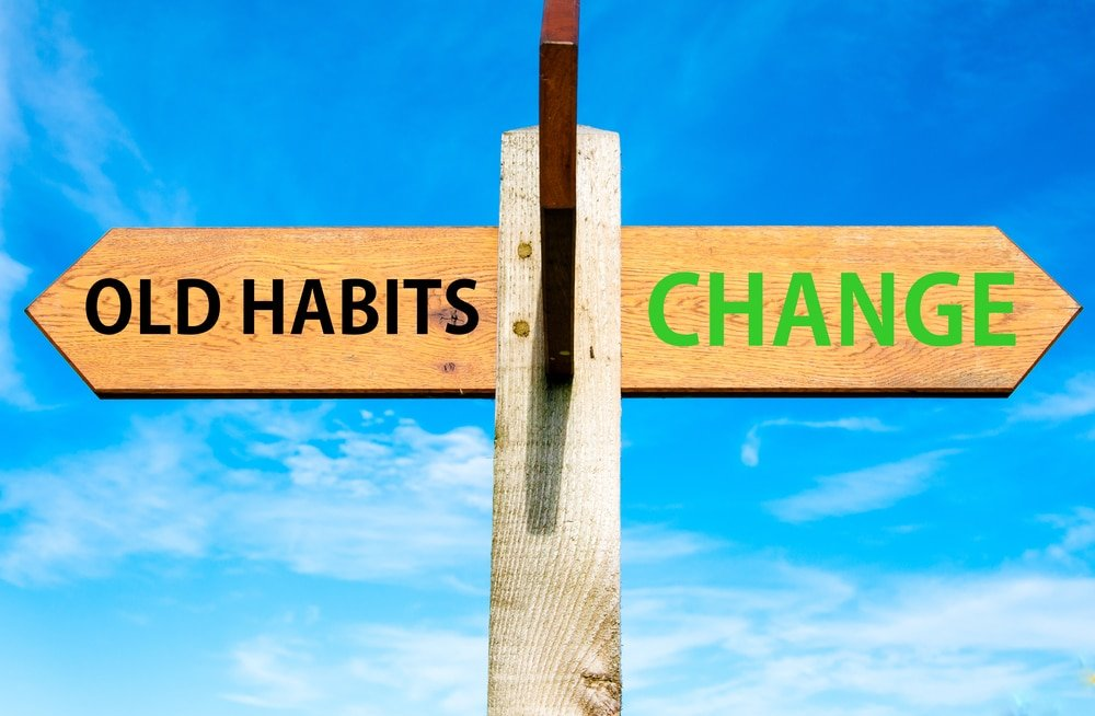 street signs, pointing in different directions, learn how to break bad habits and bring about a healthy change into your life