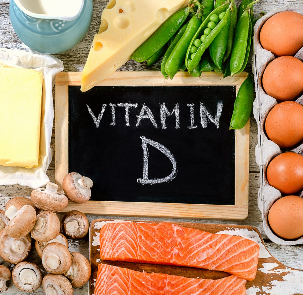 mushrooms, salmon, green beans, eggs, milk, butter, surrounding the word vitamin D