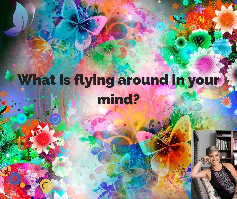 drawing of colorful butterflies and flowers, with lettering what is flying around in your mind, question is if hypnosis is real