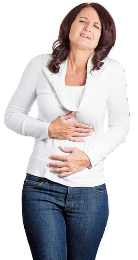 woman in white pullover and blue jeans, holding her tummy, local and online Hypnosis for IBS is a comprehensive service offered by Integrative Hypnothyerapy Boca Raton FL